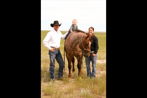 Remington Campbell, son Haaken and wife Danni with Cole Redhorse stallion, Peptos Duke